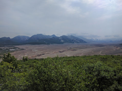 The valley is unreal, alien, and out of this planet.  It is like all the landscape around it, except the green is covered in ash and sediment with rivers carving throughout.